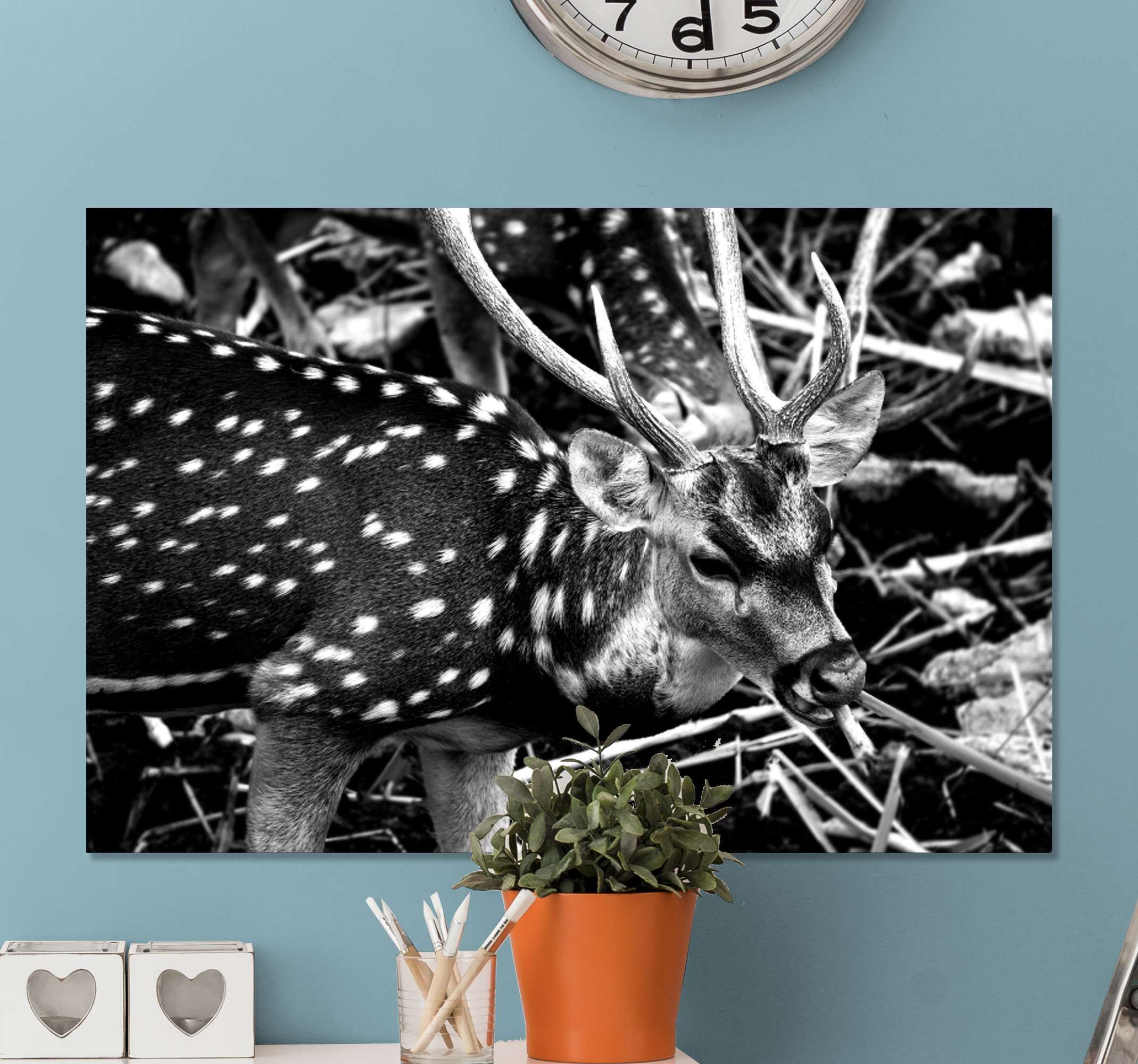 TenStickers. Black deer white dots stag canvas prints. Black deer with dots canvas design illustrated in roaming a forest. The deer depicts a male deer known as a stag. It is printed in quality finish.