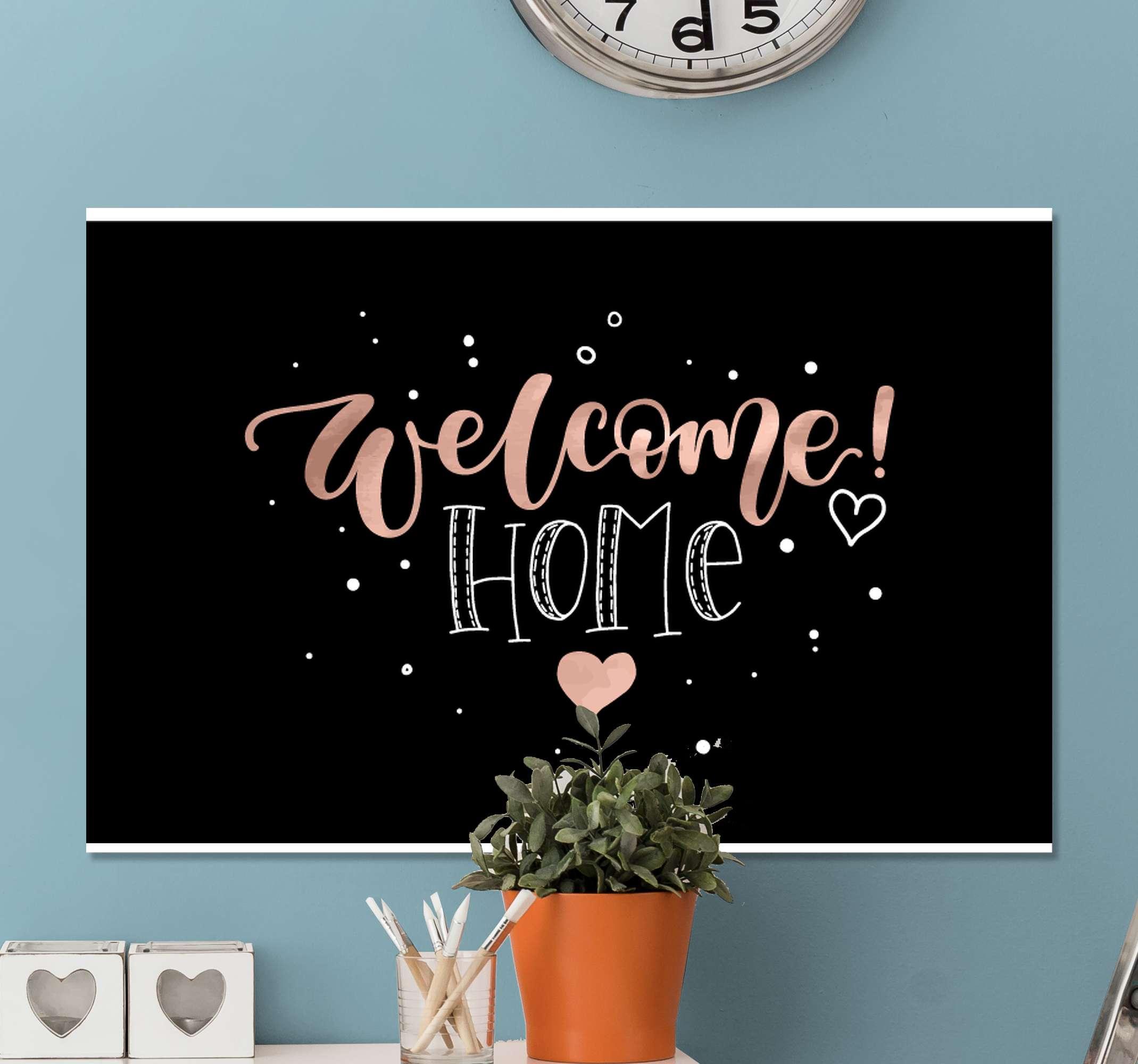 TenStickers. Quadro Decorativo hall de entrada Bem vindo coração. Tela de entrada que apresenta o texto 'bem-vindo a casa' rodeado por pequenos pontos e com um grande coração no centro. Personalizado.