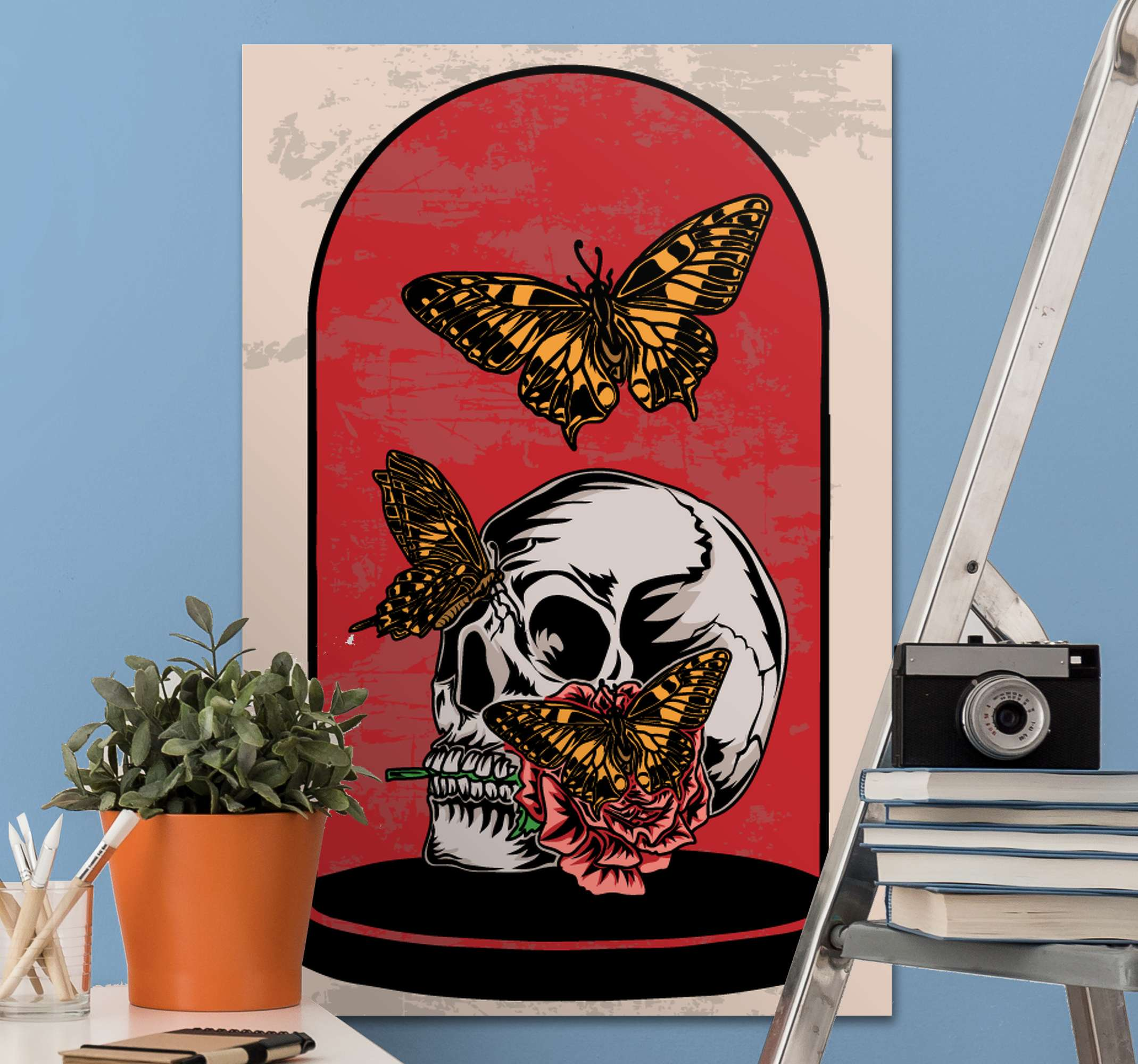 TenStickers. 时光飞逝蝴蝶蝴蝶帆布图片. 蝴蝶壁画,上面有蝴蝶的插图,周围是骷髅头,粉红色的背景是理想的选择,您可以将它放在房间的墙壁上。