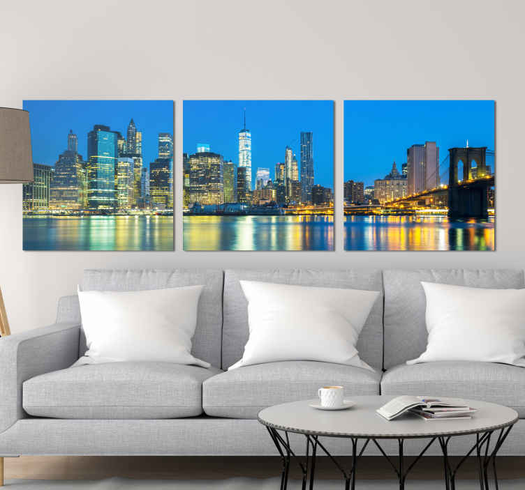 TenStickers. New York East River at night City skyline prints. Amazing view of new York city east river canvas art for your home. The design shows the amazing view of it skyscrapers, bridge and river at night.