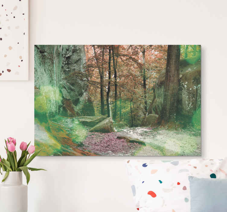 TenStickers. Green Forest Tree canvas print. Forest canvas print which features a beautiful image of a clearing in a forest with a small rocky cliff by the side of it.