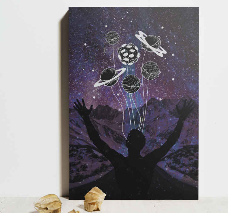 TenStickers. Universe in your hands canvas art. Universe in your hands canvas prints.  The canvas captures the silhouette of a man with hands spread out in experience of the universe and it beauty.