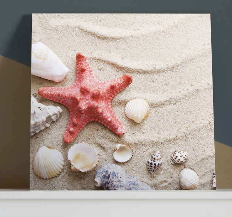 TenStickers. Starfish and shells on sand Sea life canvas wall art. A beautiful illustrative sea life canvas art  print presenting you with design of  red textured large starfish with different seashells on beach sand.