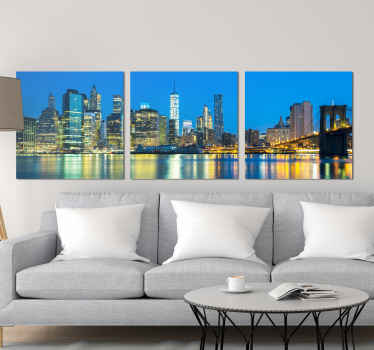 Amazing view of new York city east river canvas art for your home. The design shows the amazing view of it skyscrapers, bridge and river at night.