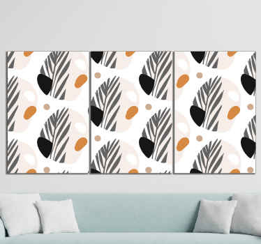 Nordic canvas print which features a pattern of abstract shapes coloured in black, orange, brown, grey and white. Discounts available.
