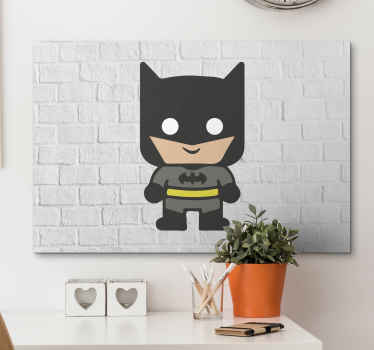 Canvas print with a baby batman, easy to hang on a wall. Made of high quality materials. It presents a small batman on a white bricky background.
