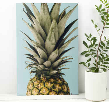 Pineapple canvas print which  features a stunning image of a pineapple on a blue background. Easy to apply to your walls.