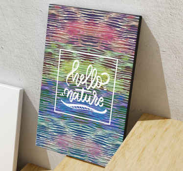 Rainbow zebra canvas print which  features the text 'hello nature' on a zebra print background which is painted in lots of different colours.