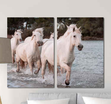 Horse canvas print which features an image of a group of white horses running through the water with a forest in the background.