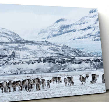 An amazing landscape with stags canvas art. The design illustrates  stag herds on a snowy mountain, moving freely and looking for food on the ground.