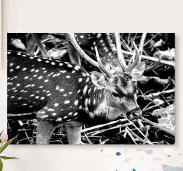 Black deer with dots canvas design illustrated in roaming a forest. The deer depicts a male deer known as a stag. It is printed in quality finish.