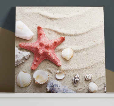 A beautiful illustrative sea life canvas art  print presenting you with design of  red textured large starfish with different seashells on beach sand.