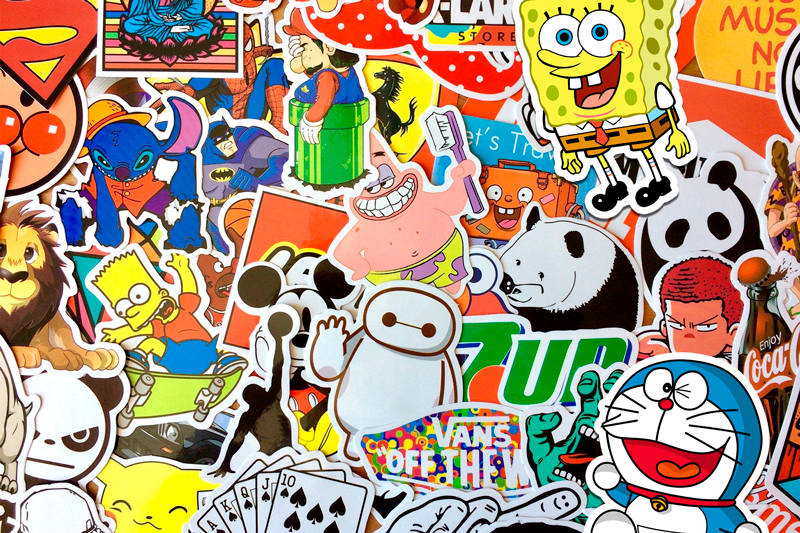 TenStickers. Cartoon Characters wall pictures for nursery. Kids canvas print which features images of various well known cartoon characters including SpongeBob, Bart Simpson, Mario and Baymax!
