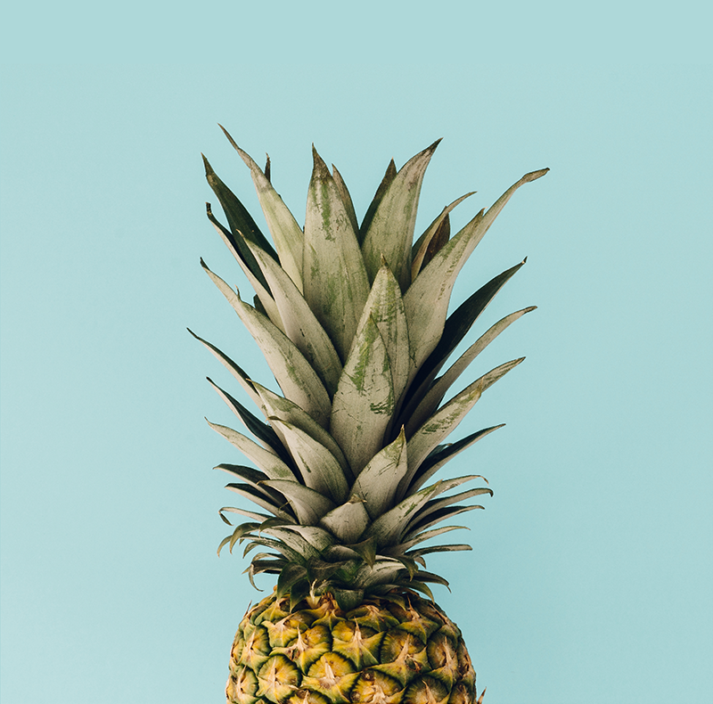 TenStickers. Pineapple Plant wall print. Pineapple canvas print which  features a stunning image of a pineapple on a blue background. Easy to apply to your walls.