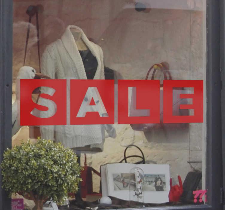 """TenStickers. 贴纸盒英国. 这个窗口商店贴纸包含用大写字母写的""""销售""""字样。"""
