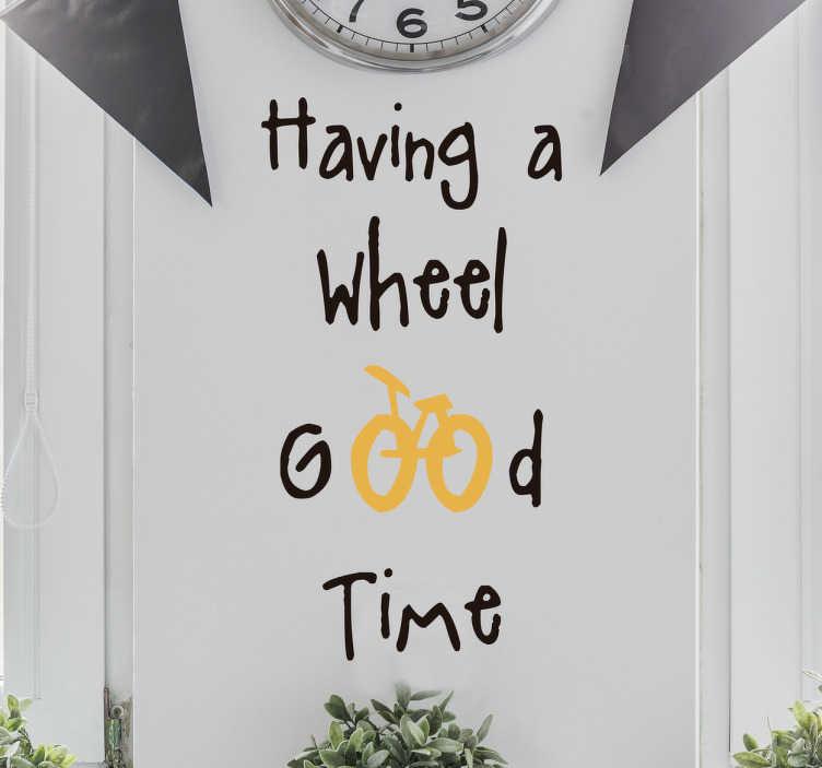 """TenStickers. Sticker having a wheel. Sticker mural dédié au monde du cyclisme avec une phrase en anglais qui se lit """"having a wheel of a time""""."""