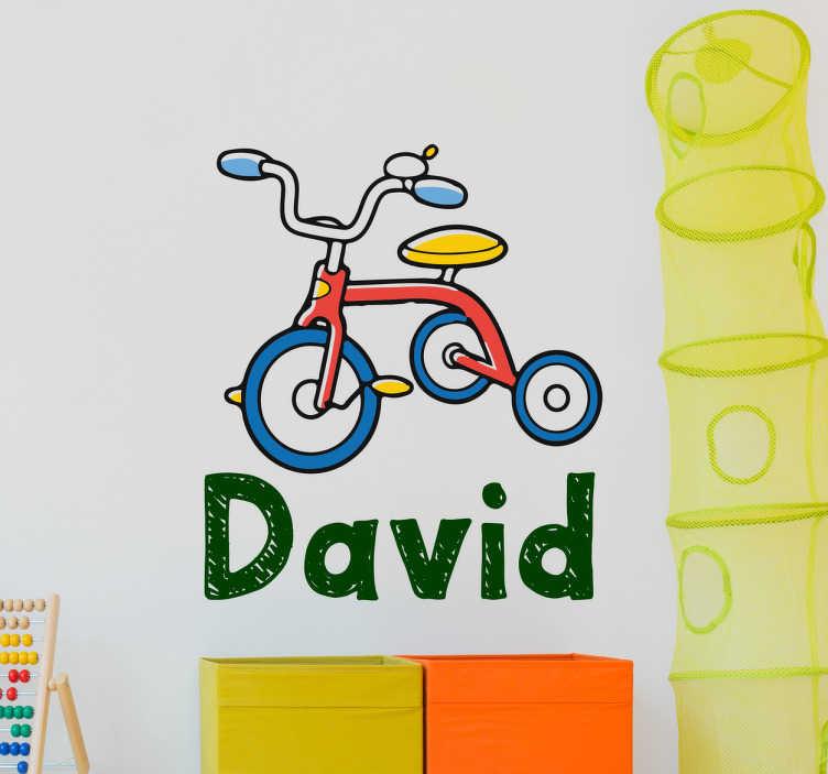 TenStickers. Sticker tricycle personnalisable. Sticker mural dédié aux enfants avec la conception colorée d'un tricycle pour personnaliser avec le nom de vos enfants.