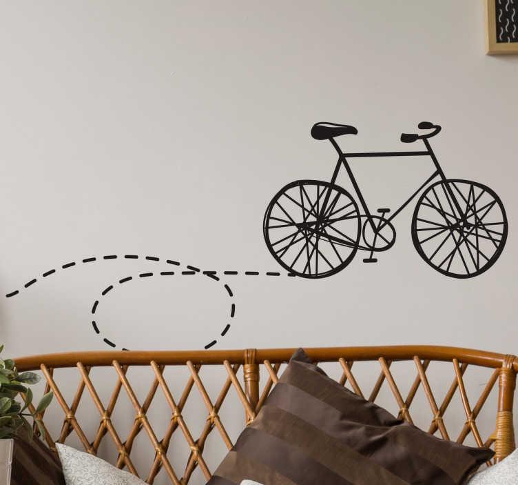 TenStickers. Muursticker fiets met stippellijntje. Muursticker met een mooie klassieke fiets met stippellijntje achter zijn wiel, hierdoor lijkt het alsof hij zelf een cirkel heeft gefietst.