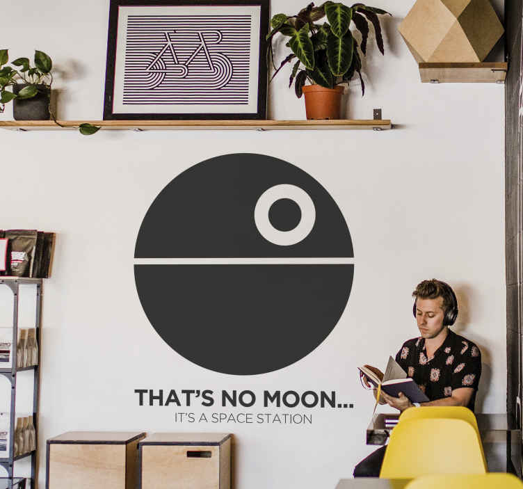 "TenStickers. Star War Death Star Wall Sticker. The wall decoration consists of the death star with the text ""That's no moon...it's a space station"" written underneath."