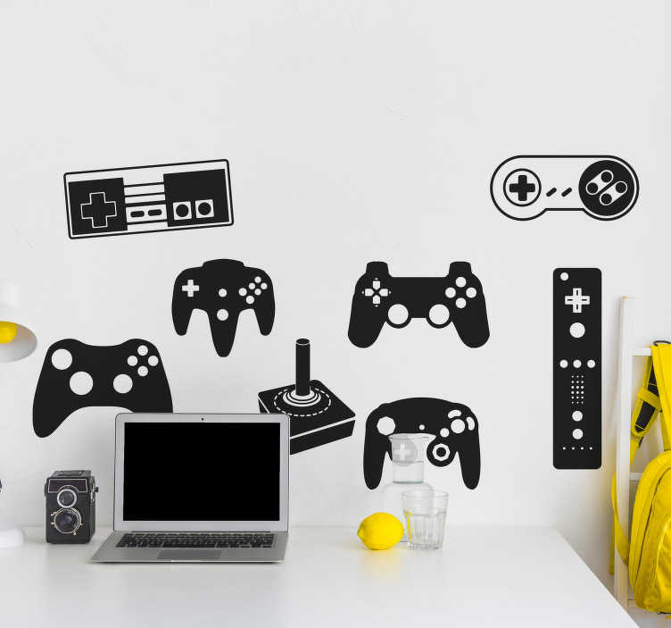 TenStickers. Wandtattoo Spielekonsolen. Dieses Wandtattoo zeigt die Controller verschiedener Spielekonsolen, unter anderem den eines SNES und einer XBOX.