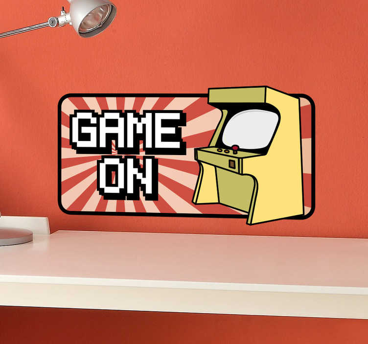 TenStickers. Sticker Arcade Game On. Sticker met daarop een spelmachine uit een ouderwetse Arcade en daarnaast de tekst Game On, een leuke decoratie voor old school gamers.