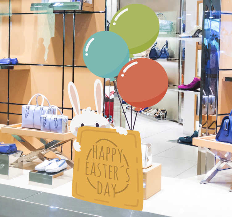 """TenStickers. Bunny Easter Window Sticker. This sticker consists of a bunny rabbit hiding behind a sign which says """"Happy Easter's Day"""" This removable sticker is available in a variety of sizes"""