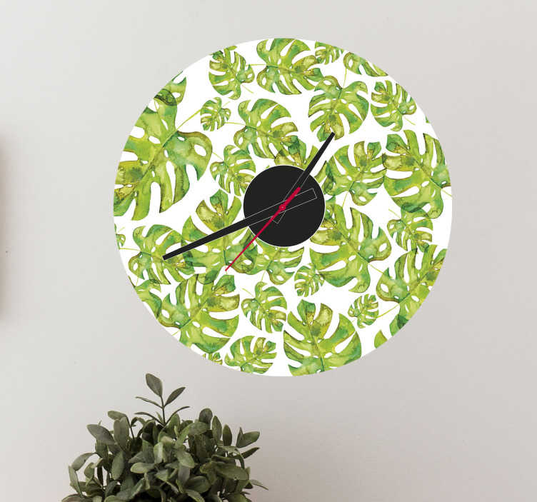 TenVinilo. Reloj decorativo de pared costilla de adán. Verdoso y floral vinilo de reloj para pared en acabado mate con muchas hojas de la planta Costilla de Adan. Envío Express en 24/48h