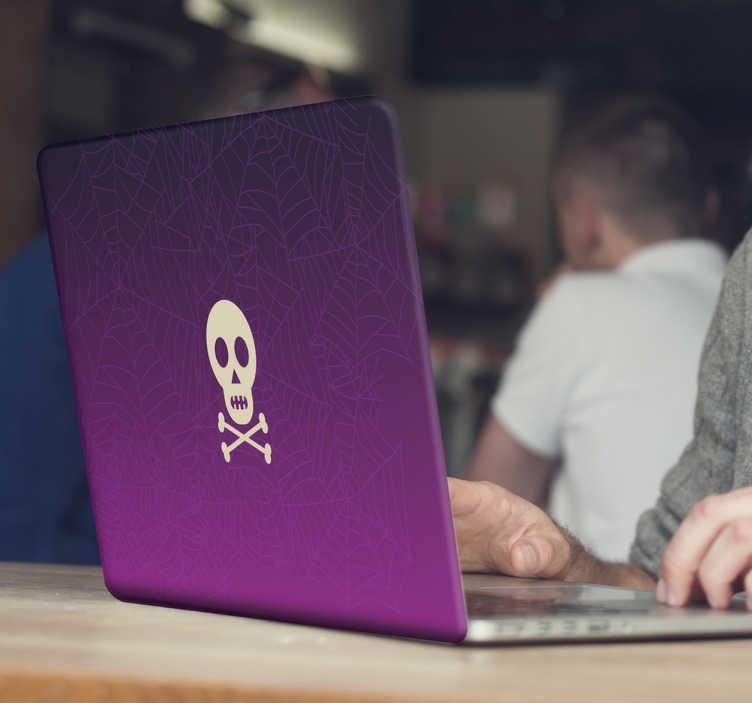TenStickers. Laptop Sticker paarse spinnenwebben en doodshoofd. Laptop sticker met verschillende paarse spinnenwebben en in het midden een wit doodshoofd met gekruiste botten eronder.