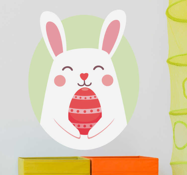 TenStickers. Easter Bunny Wall Sticker. A wall sticker for children in which the Easter Bunny is holding a coloured egg. A nice wall decoration for Easter.