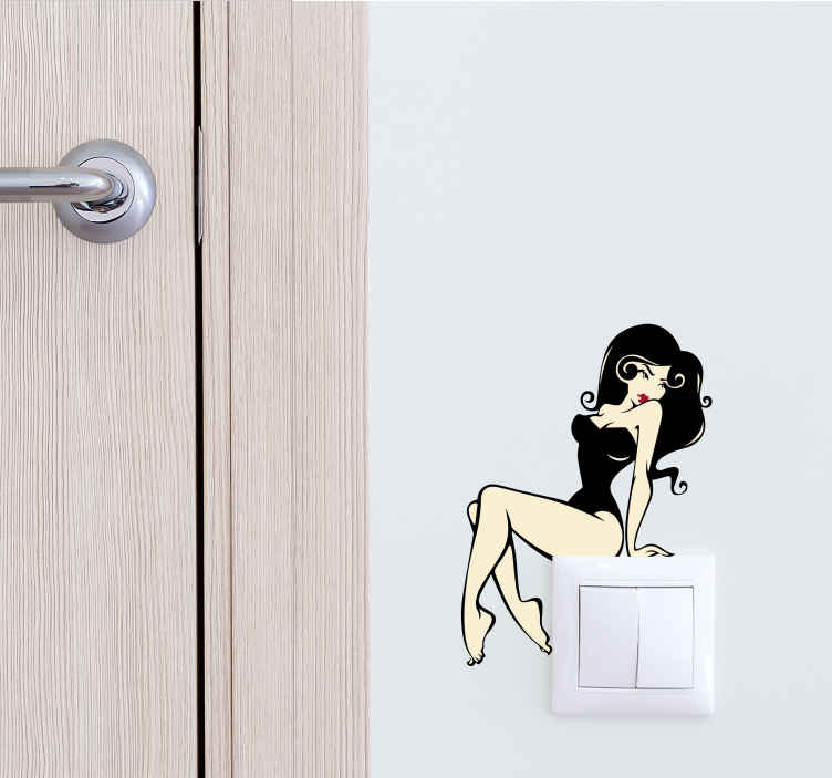 TenStickers. Model Switch Sticker. Wall Sticker for a light switch with a sexy model sitting on the light switch. The model has a black bathing suit and long black hair.