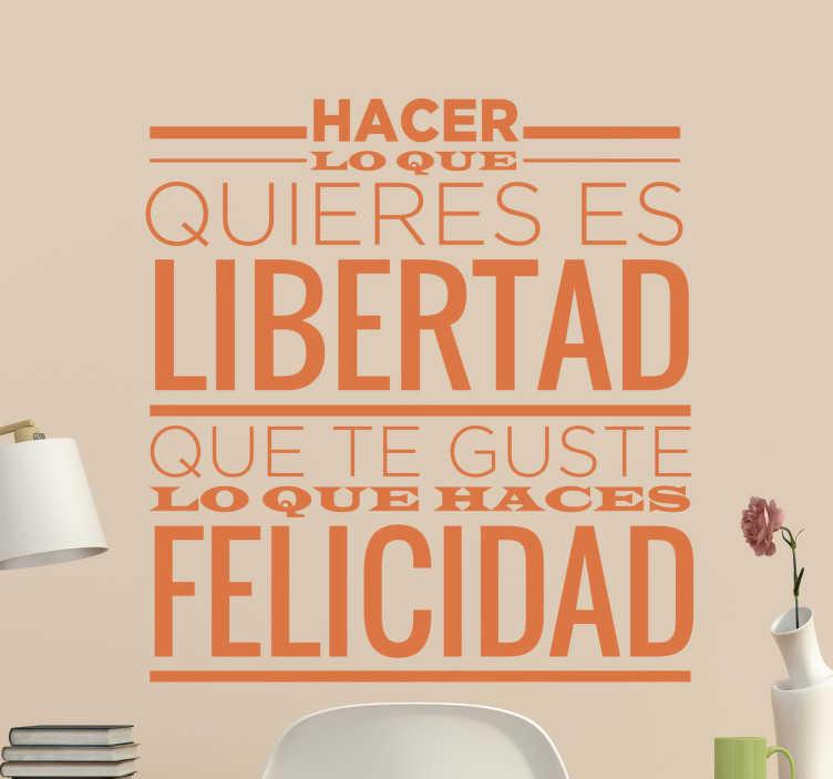 """TenVinilo. Vinilos de frases sobre la libertad. Vinilo mural con el texto """"hacer lo que quieres es libertad. Que te guste lo que haces, felicidad""""."""
