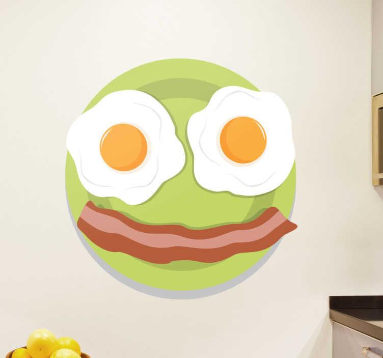 TenStickers. Wandtattoo Küche Smiley. Dieses Wandtattoo zeigt einen Smiley der durch einen grünen Teller mit zwei Spiegeleiern und einem Streifen Bacon dargestellt wird.