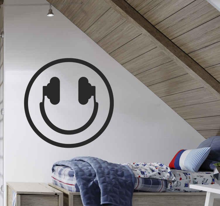 TenStickers. Muursticker muziek smiley. Decoratieve muursticker van een smiley in de vorm van een koptelefoon, perfect voor muziekliefhebbers. Voordelig personaliseren.