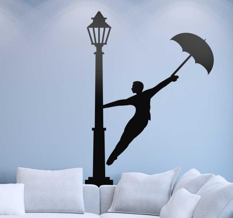 TenStickers. Wandtattoo Laterne Schirm. Dieses Wandtattoo zeigt einen Mann, der sich an einer Laterne festhält. In der anderen Hand hat er einen Regenschirm.