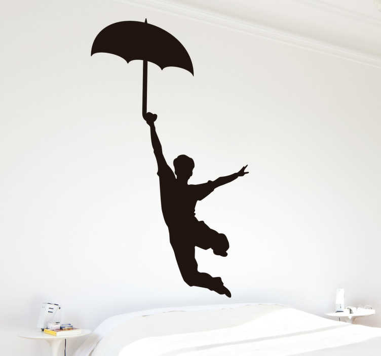 TenStickers. Wandtattoo Junge am Regenschirm. Dieses Wandtattoo zeigt einen stilisierten Jungen oder Mann, der an einem Regenschirm zu fliegen scheint.