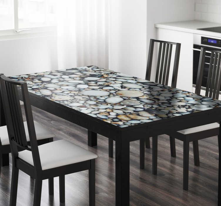 TenVinilo. Vinilo Ikea mesas textura guijarros. Renueva tu catálogo Ikea personalizándolo y adaptándolo a tus gustos estéticos con vinilos decorativos exclusivos.