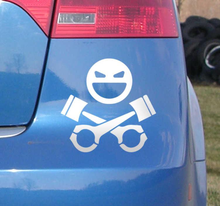 TenStickers. Naklejka na samochód - Czaszka i tłoki. Naklejka na samochód przedstawiająca uśmiechniętą czaszke i skrzyżowane tłokis amochodowe.