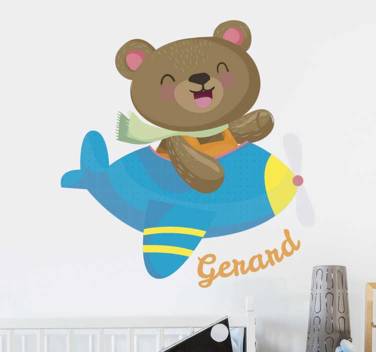 TenVinilo. Vinilo osito avión personalizable. Vinilos para niños y niñas con un divertido dibujo de un oso de peluche subido en  un aeroplano. Podrás personalizar el nombre.