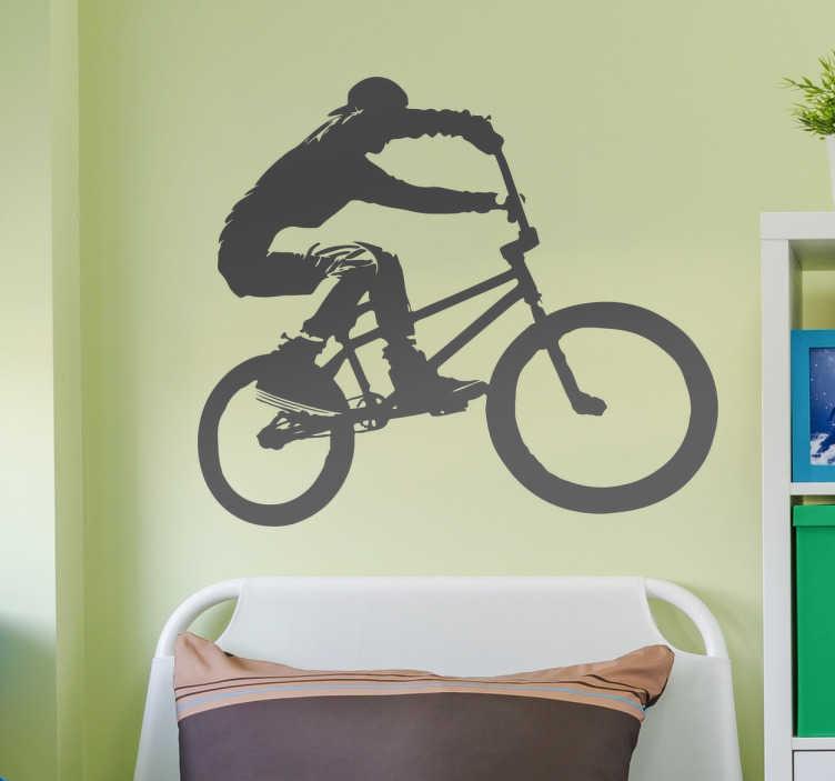 TenStickers. Naklejka na ścianę bmx freestyle. Winylowa naklejka na ścianę z sylwetką rowerzysty na BMX wykonującego akrobację w powietrzu