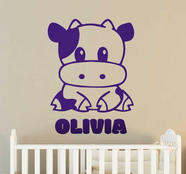 TenVinilo. Vinilo decorativo vaquita personalizable. Vinilos infantiles de nombre personalizable con un lindo dibujo de una vaca y el texto que desees en la parte inferior.