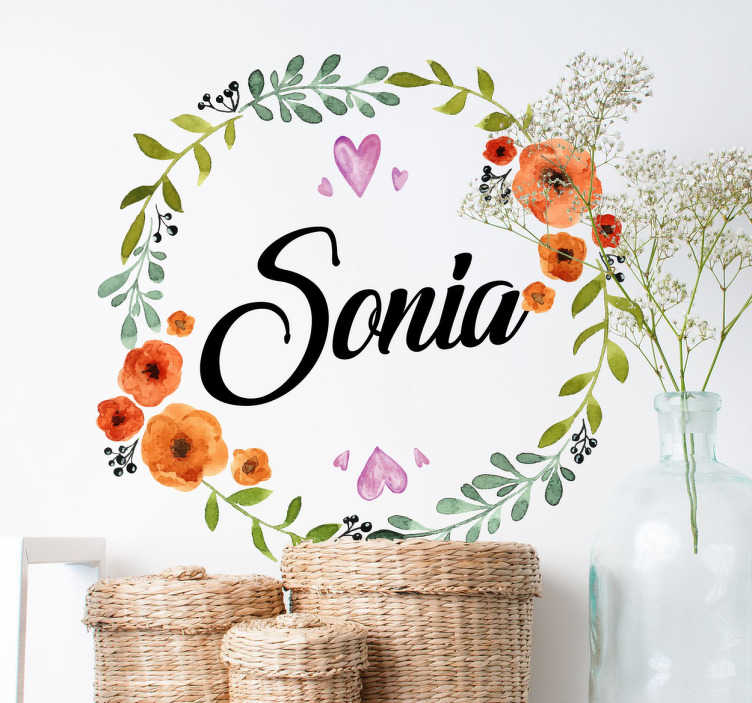 TenVinilo. Vinilo decorativo floral personalizable. Vinilo pared personalizable con un colorido dibujo de una corona de flores y el texto que quieras en el interior de la composición.