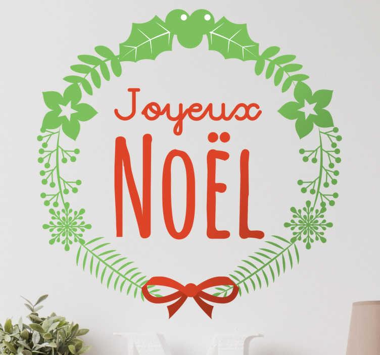 TenStickers. Sticker laurier Joyeux Noel. Sticker avec comme design la phrase Joyeux Noel écrit en rouge entouré d'un laurier. Parfait pour donner l'ambiance de noël dans votre maison.