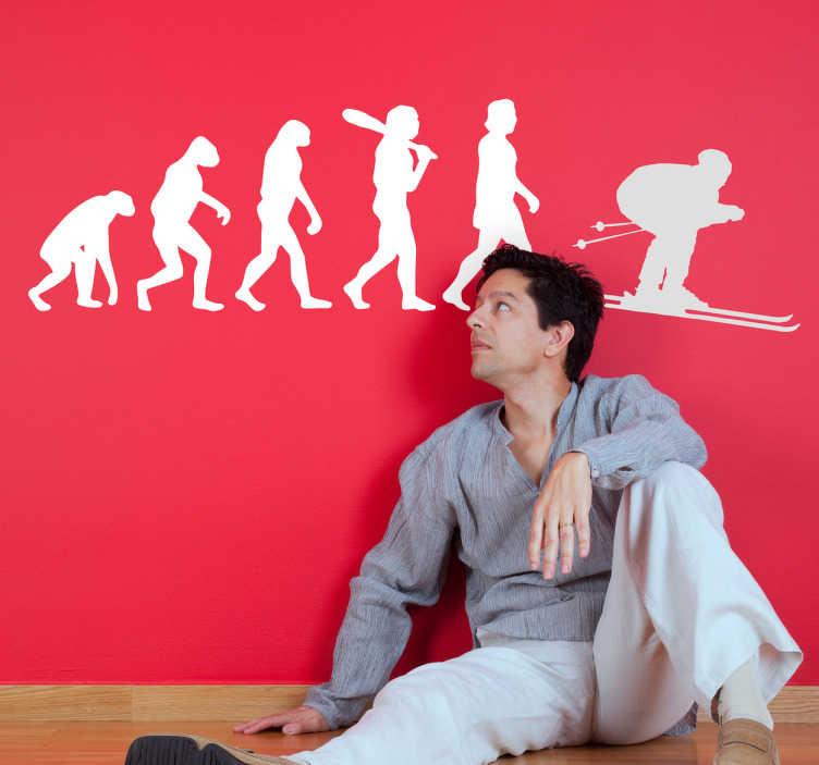 TENSTICKERS. スキーヤーの人間の進化の壁の装飾. アウストラロピテクスからホモサピエンスへと人類が進化し、スキーヤーのシルエットで終わるウィンタースポーツファンのためのポートウォールステッカー。