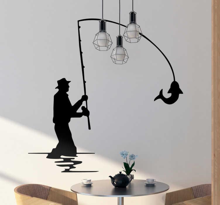 TenStickers. Sticker silhouette pêcheur. Sticker de la silhouette d'un pêcheur dans l'eau avec un poisson à la tete de la canne à pêche pour les passionnés de pêche.