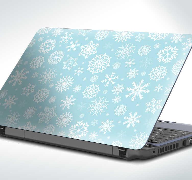 TenStickers. Laptopsticker sneeuwvlokken. Sticker voor op uw laptop, met een mooi patroon van sneeuwvlokken. Geef uw laptop een heerlijk winterse look met deze stijlvolle laptopsticker.