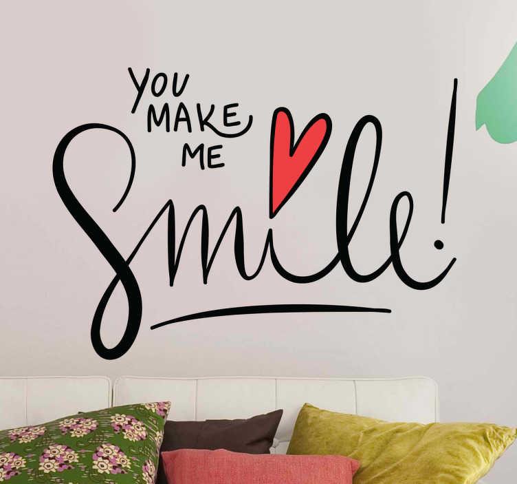 """TenVinilo. Vinilo decorativo you make me smile. Vinilos de frases positivas en inglés con un diseño tipo lettering o caligrafía escrita a mano y el texto """"tu me haces sonreír""""."""