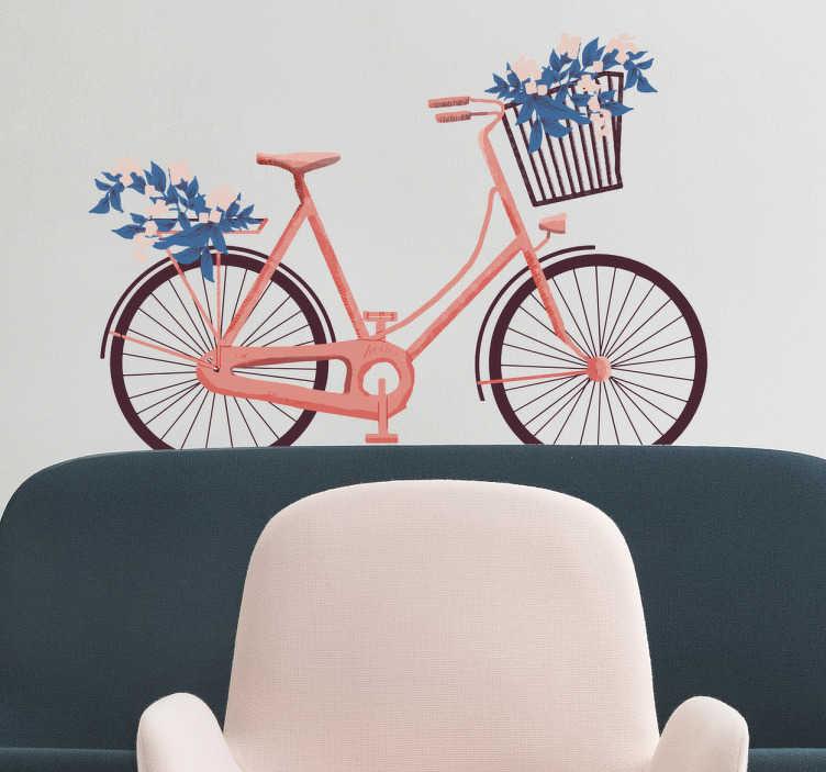 TenVinilo. Vinilo decorativo bici flores. Vinilos bicicletas de aspecto retro con una bonita ilustración de tu vehículo favorito en tonos rosados y ramos de flores azules.