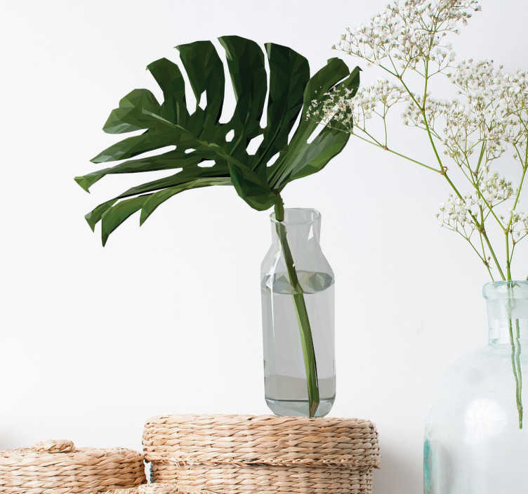 TenStickers. Muursticker gatenplant blad in vaas. Een praktische vervanging voor een kamerplant is een plant muursticker! Neem bijvoorbeeld deze fraaie decoratie sticker van een gatenplant blad.