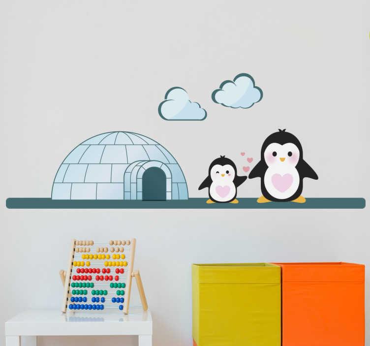TenStickers. Igloo pro děti nálepky pro děti. Ozdobte svůj dětský pokoj pomocí naší barevné nálepky igloo. Na této nálepce jsou na ledové palbě na vstupu jejich iglu dva tučňáci.