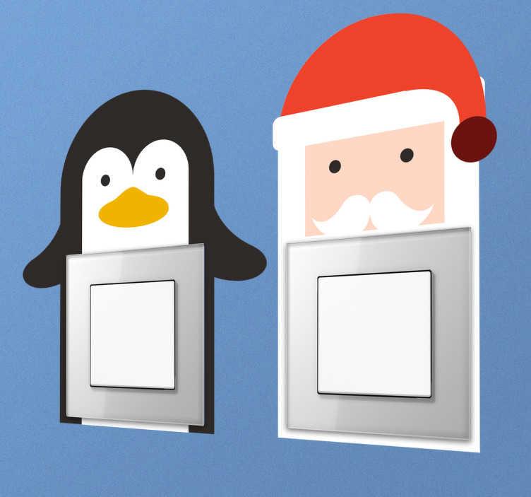 TenStickers. Schakelaarstickers voor kerst. Twee schattige schakelaarstickers voor tijdens de feestdagen. Een kerstman en een penguin als wanddecoratie voor kerst.